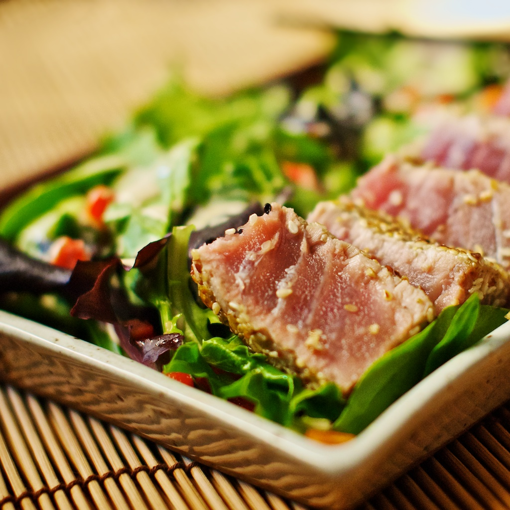 Remove seared tuna to a cutting board and slice into 1/4 to 1/2 strips ...