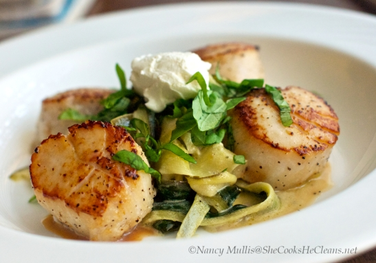 Scallops with zucchini ribbons and goat cheese